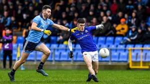 Longford's Iarla O'Sullivan gets a shot away under attention from Dublin's Andy Foley