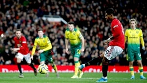 Marcus Rashford slots home his second from the spot