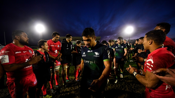 Jarrad Butler of Connacht leads his team-mates off the pitch