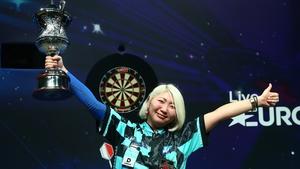 Mikuru Suzuki poses with the trophy