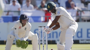 South Africa's Vernon Philander (R) plays a shot as England's Jos Buttler (L) looks on during the fifth day of the second Test