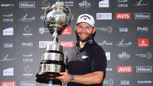 Branden Grace of South Africa celebrates with the trophy