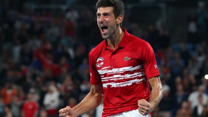 Novak Djokovic of Serbia celebrates after defeating Spain in the ATP Cup Final