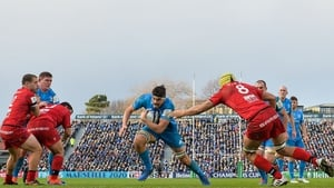 Max Deegan (centre) bursts through to take his try at the RDS