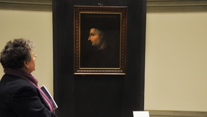 A visitor views a painting of Niccolo Machiavelli by Cristofano dell'Altissimo at Biblioteca Nazionale Centrale di Firenze in Florence. Photo: Laura Lezza/Getty Images