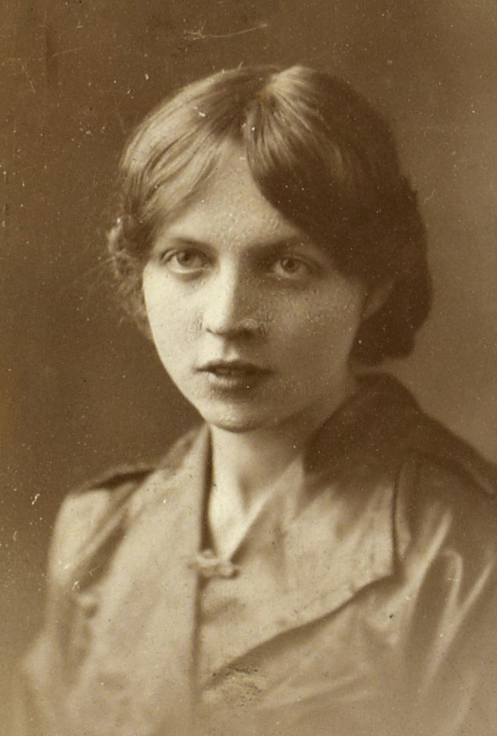 Image - Unknown girl wearing her Cumann na mBan pin. Image courtesy of the National Library of Ireland