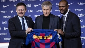 Former player Eric Abidal was on hand to present the new coach with a personalised jerse