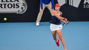 Ashleigh Barty of Australia hits a return to Anastasia Pavlyuchenkova