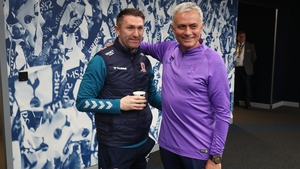 Jose Mourinho, manager of Tottenham Hotspur (R) shakes hands with Robbie Keane, assistant Manager of Middleborough (L) ahead of the FA Cup replay