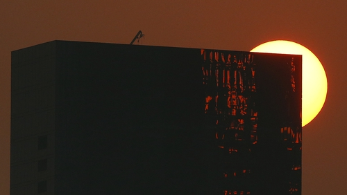 The sun sets during Australian Open qualifying at Melbourne Park