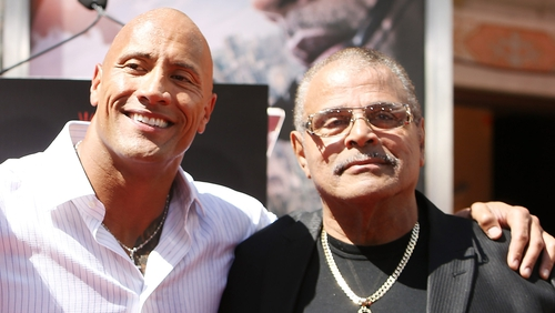 Dwayne Johnson and Rocky Johnson pictured at Dwayne Johnson's hand/footprint ceremony in Hollywood in May 2015