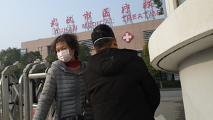 People in Wuhan wear face masks as health authorities deal with virus outbreak
