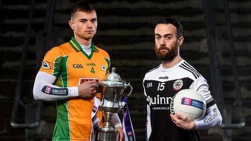 Corofin's Liam Silke, left, with Conor Laverty of Kilcoo
