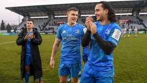 James Lowe, right, and Garry Ringrose applaud the away support after victory away to Benetton