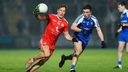 Tyrone's Kieran McGeary escapes the attention of Monaghan's Shane Carey