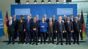 Chancellor Angela Merkel welcomes world leaders to the talks in Berlin