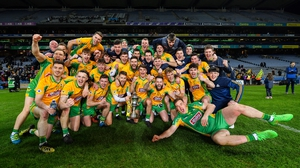 Corofin players celebrate with the Andy Merrigan Cup