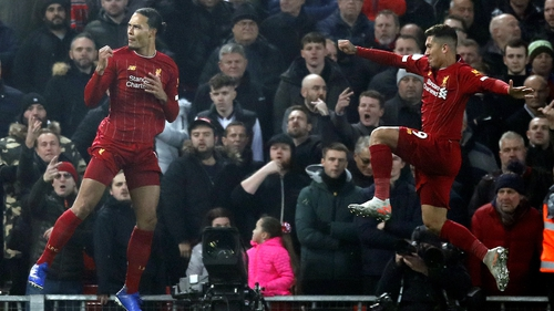 Virgil van Dijk and Roberto Firmino celebrate the opening goal against Mancheser United at Anfield