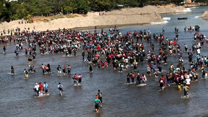Migrants mostly from Honduras cross the Suichate River on the Guatemala, Mexico border