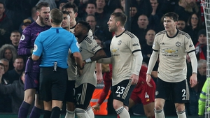 Irate Man United players remonstrate with referee Craig Pawson at Anfield