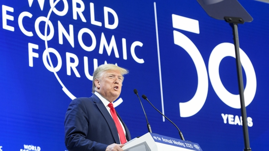 Trump in Davos as impeachment trial begins