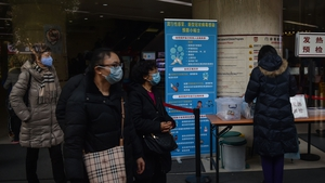 People wear face masks as the SARS-like virus continue to spread