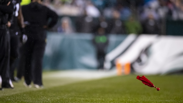 Detail view of a red challenge flag as it flies after being thrown by Head coach Doug Pederson of the Philadelphia Eagles