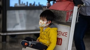 A young boy wears a facemask at Hong Kong airport