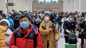 Airlines are on guard against a new flu-like virus that originated in Wuhan
