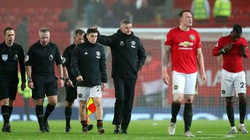 Manchester United manager Ole Gunnar Solskjaer consoles Daniel James