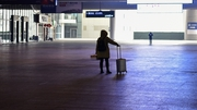 A passenger arrives at the nearly-deserted Wuhan train station
