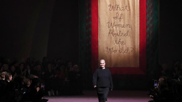 Designer Maria Grazia Chiuri accepts applause after the Dior Haute Couture Spring/Summer 2020 fashion collection (Francois Mori/AP)