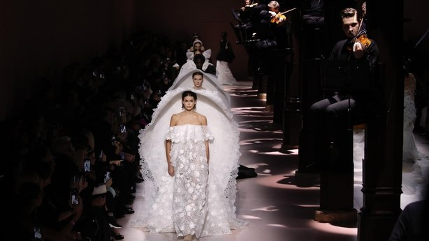 Model Kaia Gerber leads other models as they wear creations for the Givenchy Haute Couture Spring/Summer 2020 fashion collection (Christophe Ena/AP)