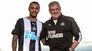 Valentino Lazaro (L) with Newcastle United boss Steve Bruce