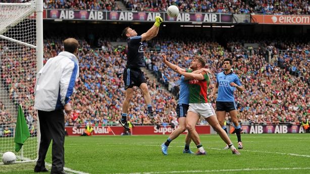 Stephen Cluxton, Aidan O'Shea and Philip McMahon contest a high ball