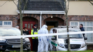 The bodies of the three children were removed today from the house at Parson's Court in Newcastle village (Pics: RollingNews.ie)