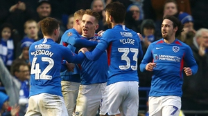 Ronan Curtis is mobbed after scoring for Portsmouth