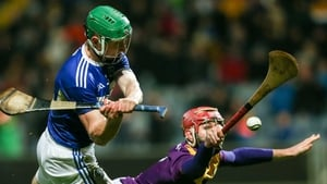 Ross King of Laois in action against Paudie Foley of Wexford