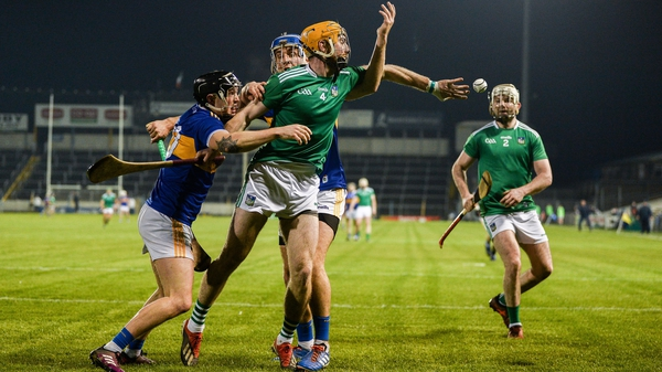 Richie English of Limerick gets a handpass away to team-mate Tom Condon