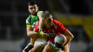 Sean White of Cork in action against Offaly's Ruairi McNamee