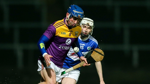 Kevin Foley of Wexford (L) holds off Stephen Bergin