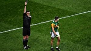 Referee Seán Hurson shows a black card to Graham O'Sullivan of Kerry