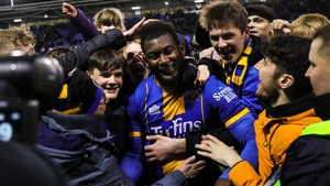Aaron Pierre is mobbed by Shrewsbury fans after their win against Bristol City