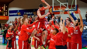 Lorcan Murphy of Griffith College Templeogue celebrates with his team-mates after being named MVP