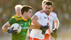 Donal Keogan of Meath (L)holds off Tyrone's Darren McCurry