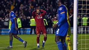 Mohamed Salah (C) reacts to missing a header late in the game