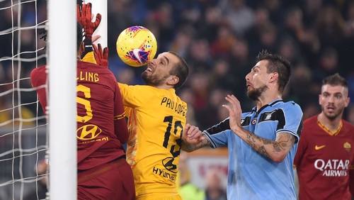 Lazio's Francesco Acerbi equalises despite the best efforts of Roma keeper Pau Lopez and Chris Smalling.