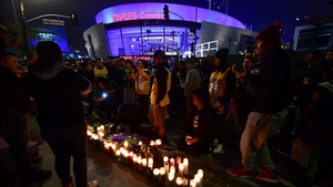 Fans staged a candlelight vigil at the Lakers' home