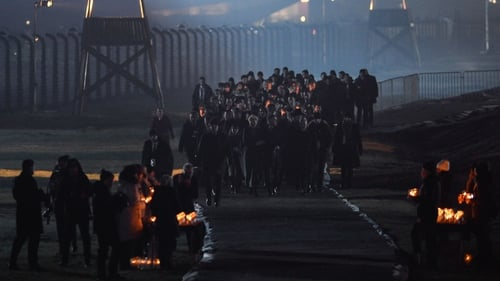 As night fell, survivors and dignitaries carried flickering candles as they walked along the railway that brought Jews from across Europe to the gas chambers