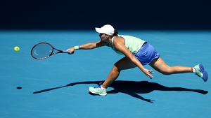 Ashleigh Barty lunges to make a forehand on Rod Laver Arena